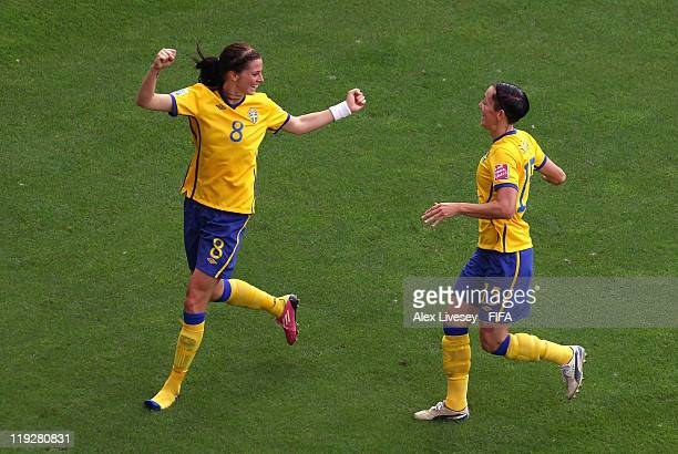 Lotta Schelin of Sweden celebrates with Therese Sjogran after scoring the opening goal during the FIFA Women's World Cup 3rd Place Playoff between...