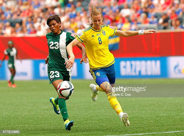 Lotta Schelin of Sweden challenges Ngozi Ebere of Nigeria during the FIFA Women's World Cup Canada 2015 Group D match between Sweden and Nigeria at...