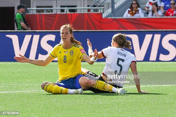 Lotta Schelin of Sweden gestures for a call after a collision with Annike Krahn of Germany during the FIFA Women's World Cup Canada 2015 round of 16...