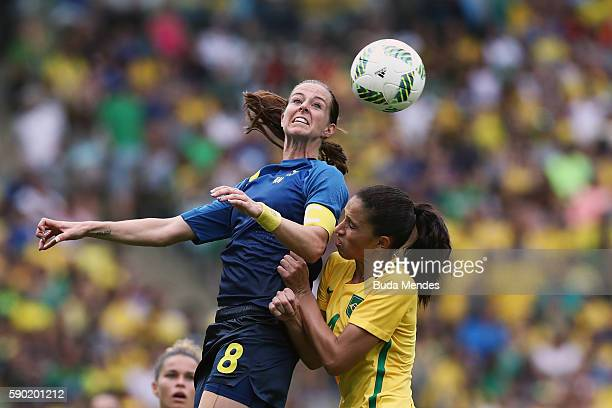 Lotta Schelin of Sweden heads the ball during the Women's Football Semi Final between Brazil and Sweden on Day 11 of the Rio 2016 Olympic Games at...