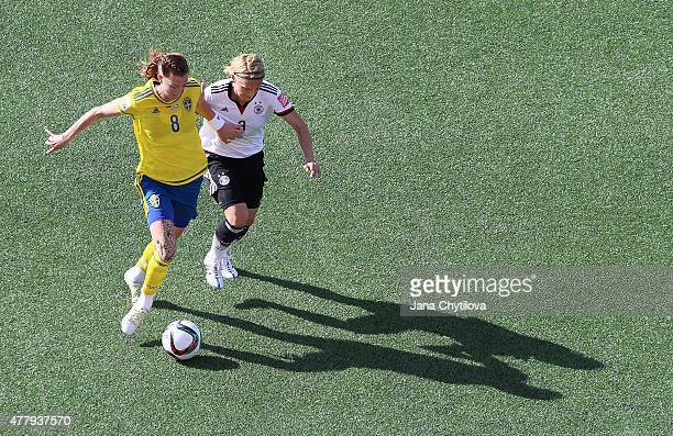 Lotta Schelin of Sweden keeps Saskia Bartusiak of Germany at bay with her arm during the FIFA Women's World Cup Canada 2015 round of 16 match between...