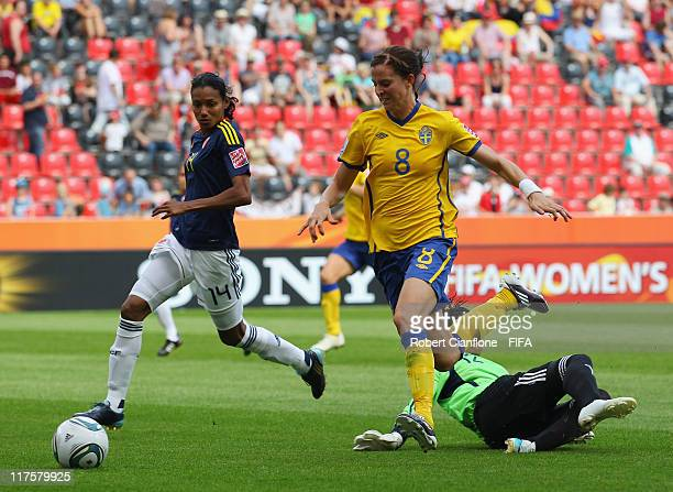 Lotta Schelin of Sweden runs with the ball during the FIFA Women's World Cup 2011 Group C match between Colombia and Sweden at the BayArena on June...