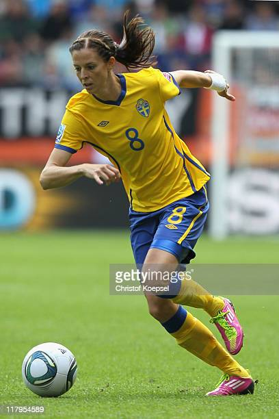 Lotta Schelin of Sweden runs with the ball during the FIFA Women's World Cup 2011 Group C match between North Korea and Sweden at FIFA World Cup...