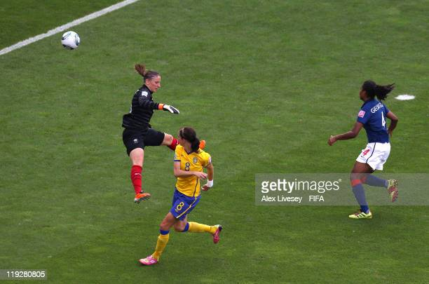 Lotta Schelin of Sweden scores past Berangere Sapowicz of France for the opening goal during the FIFA Women's World Cup 3rd Place Playoff between...