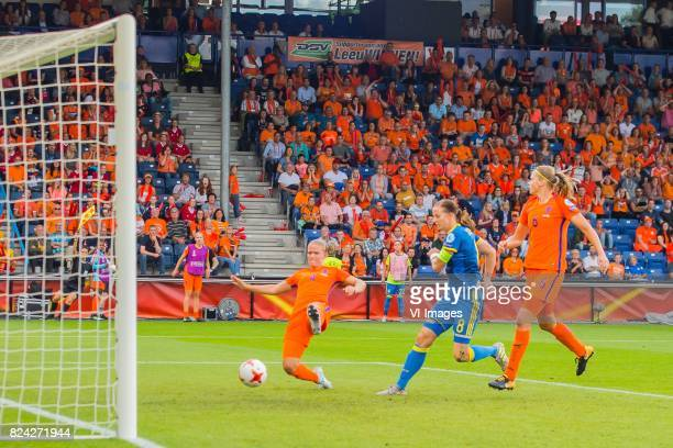 Lotta Schelin of Sweden women scores after a faul Mandy van den Berg of Holland Women Lotta Schelin of Sweden women Anouk Dekker of Holland Women...