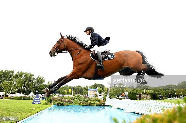 Lotta Shultz of Sweden ridding London Calling going over the water jump during the Longines King George V Gold Cup at the Longines International...