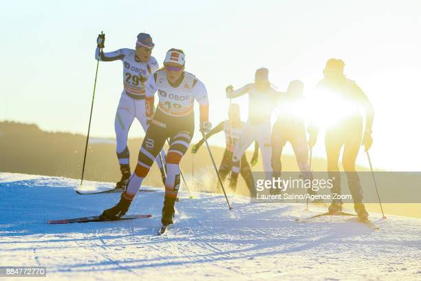 Lotta Udnes Weng of Norway competes Ainokaisa Saarinen of Finland competes during the FIS Nordic World Cup Men's and Women's Cross Country Skiathlon...