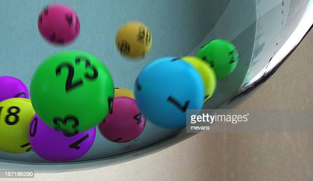 Lottery numbers rolling around in container