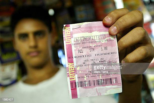 Lottery salesman Malek Yibran holds a winning New York State Lottery ticket stub which was purchased for $100 September 13 2002 in New York City The...