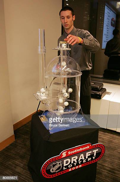 Lottery technician Nick Iocco loads the lottery balls during the 2008 NHL Draft Drawing on April 7 2008 at the National Hockey League headquarters in...