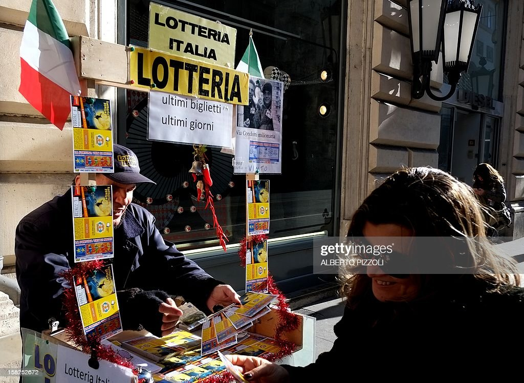 A lottery tickets seller shows tickets in a street of Rome on December 12, 2012.