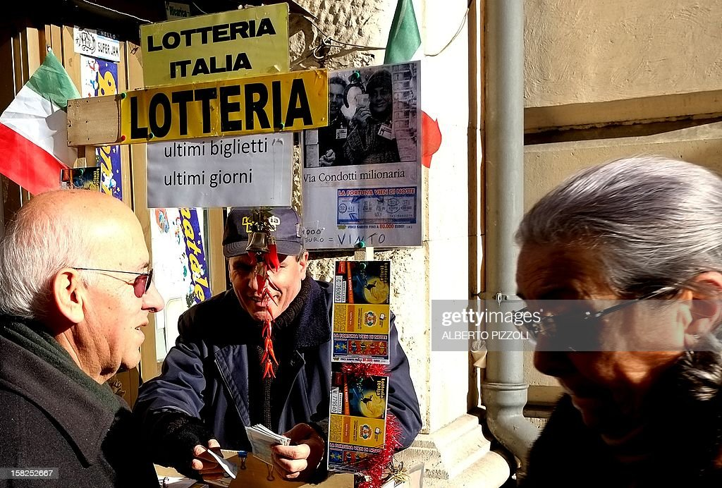 A lottery tickets seller stands in a street of Rome on December 12, 2012. AFP PHOTO / ALBERTO PIZZOLI