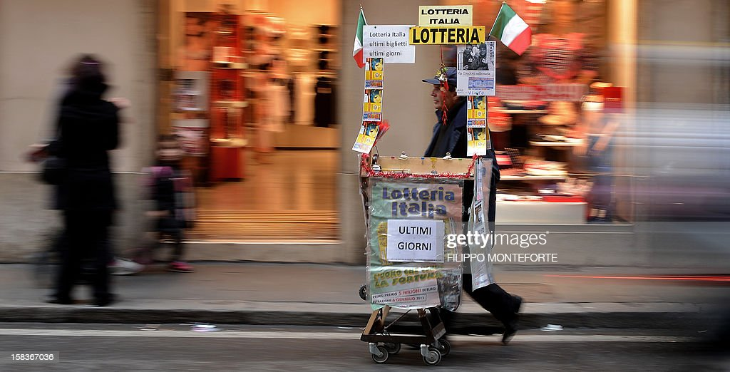 A lottery tickets streetseller walks in downtown Rome on December 14, 2012. Italy's public debt crossed the two-trillion-euro mark for the first time in October when it reached a record high of 2.014 trillion, the Bank of Italy said on Friday. AFP PHOTO/ Filippo MONTEFORTE