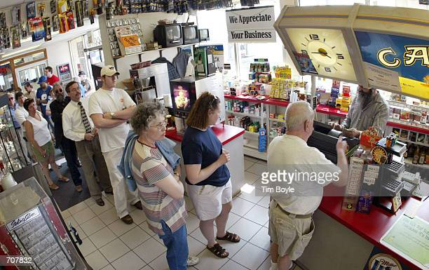 Lotterywinning hopefuls are seen as they wait in line to buy their Big Game lottery tickets inside a Citgo gas station April 16 2002 in Russell...