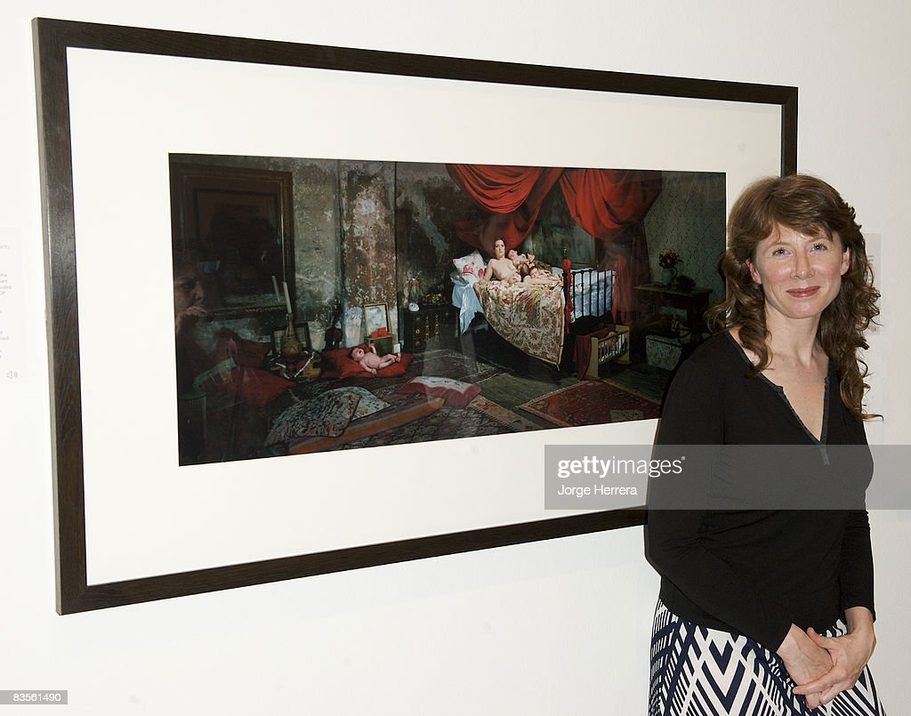 Lottie Davies, 1st prize winner of National Portrait Gallery's Taylor Wessing Award 2008, poses next to her winning photograph at the National Portrait Gallery on November 4, 2008 in London, England.