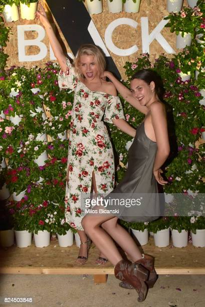 Lottie Moss and Vittoria Ceretti pose for a photo during the Velocity Black party on July 29 2017 in Mykonos Greece