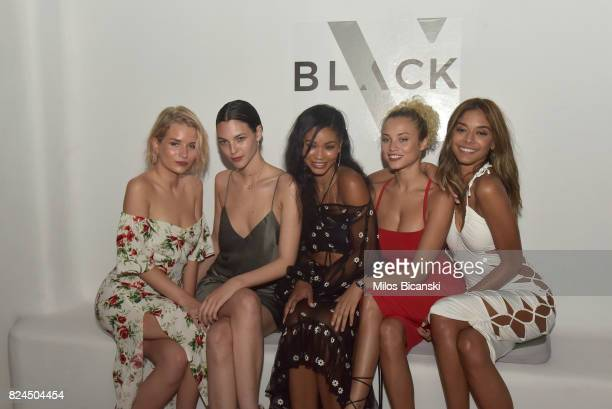 Lottie Moss Vittoria Ceretti Chanel Iman Rose Bertram and Heidy De La Rosa pose for a photo during the Velocity Black party on July 29 2017 in...