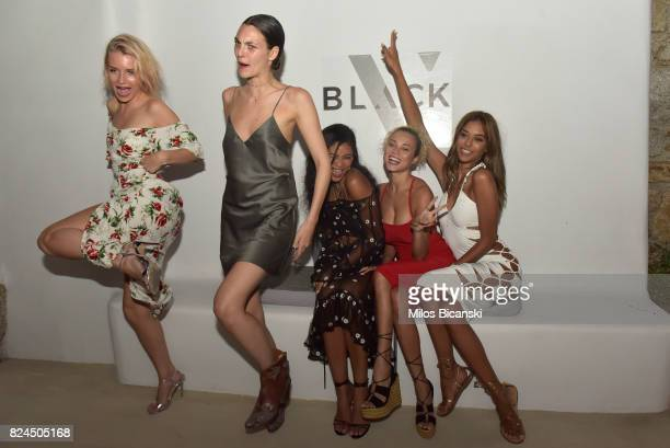 Lottie Moss Vittoria Ceretti Chanel Iman Rose Bertram Heidy De La Rosa pose for a photo during the Velocity Black party on July 29 2017 in Mykonos...