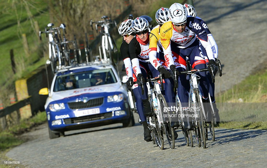 Lotto - Belisol team ride on the 'Haaghoek' during a track reconnaissance in Horebeke on February 18, 2013 ahead of the 'Omloop Het Nieuwsblad', the first cycling race of the season in Belgium.
