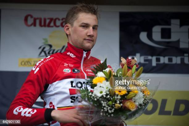 Lotto Soudal Belgian cyclist Tim Wellens celebrates on the podium after winning the last stage of the 'Ruta del Sol' tour a 1515 km ride from Setenil...
