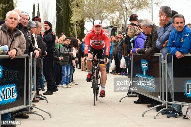 Lotto Soudal's German rider Andre Greipel rides to the signature control before the start before the start of the fifth stage of the 97th Volta...