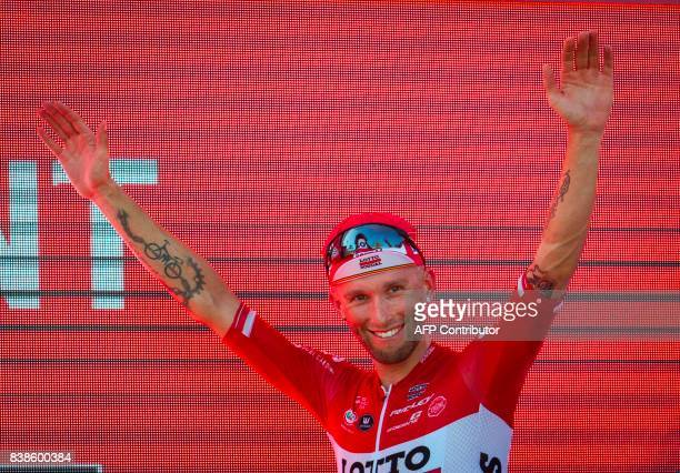 Lotto Soudal's Polish cyclist Tomasz Marczynski celebrates on the podium after winning the 6th stage of the 72nd edition of 'La Vuelta' Tour of Spain...