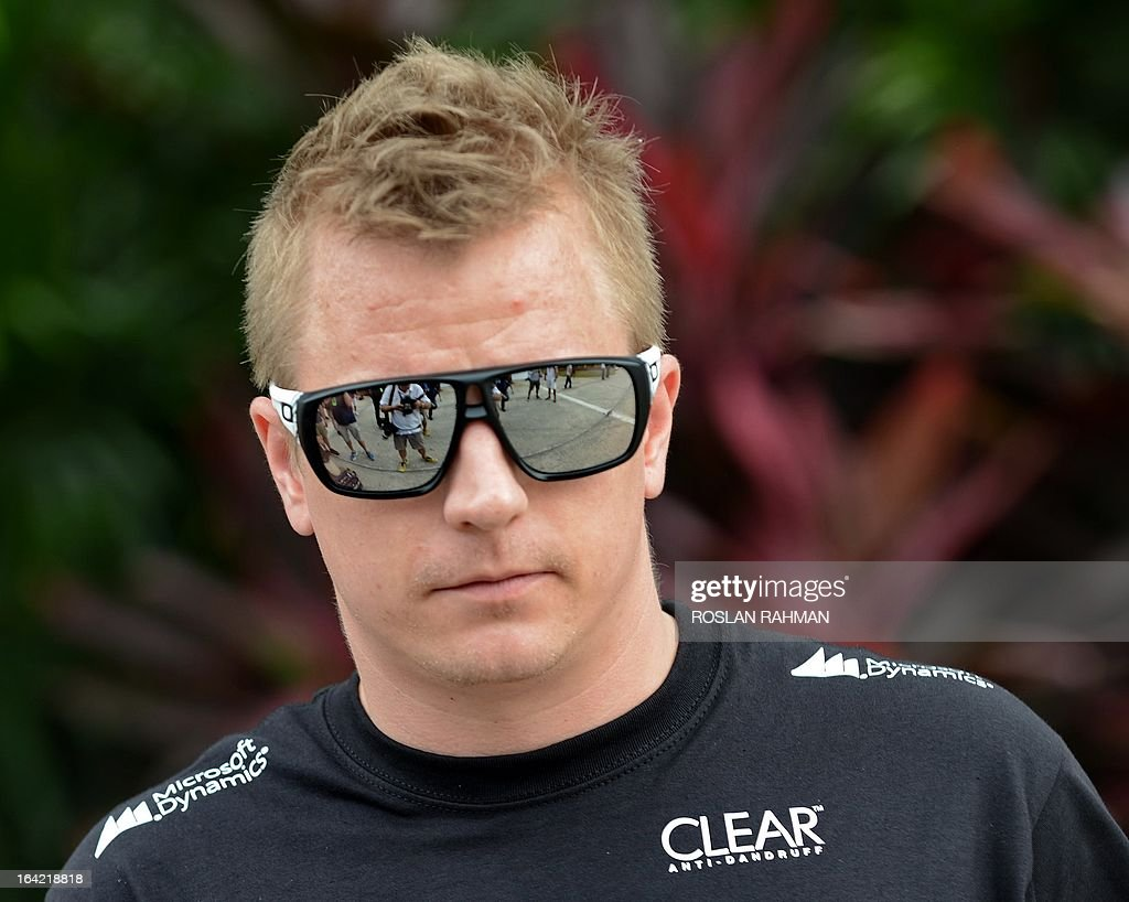 Lotus driver Kimi Raikkonen of Finland is seen along the paddock ahead for the Formula One Malaysian Grand Prix at Sepang on March 21 , 2013. The Malaysian Grand Prix will take place on March 24. AFP PHOTO / ROSLAN RAHMAN
