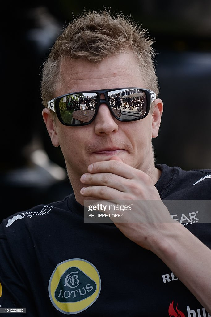 Lotus driver Kimi Raikkonen of Finland looks on in the paddock ahead of the Formula One Malaysian Grand Prix in Sepang on March 21, 2013. The Malaysian Grand Prix takes place on March 24. AFP PHOTO / Philippe Lopez
