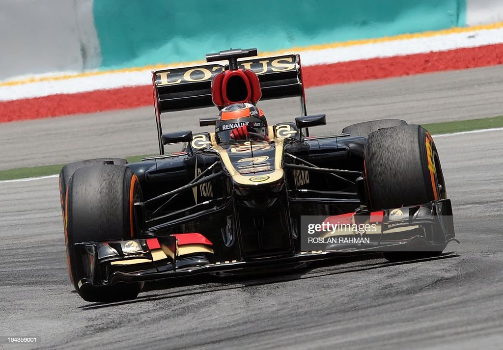 Lotus driver Kimi Raikkonen of Finland takes a corner during the third practice session of the Formula One Malaysian Grand Prix at Sepang on March 23, 2013.