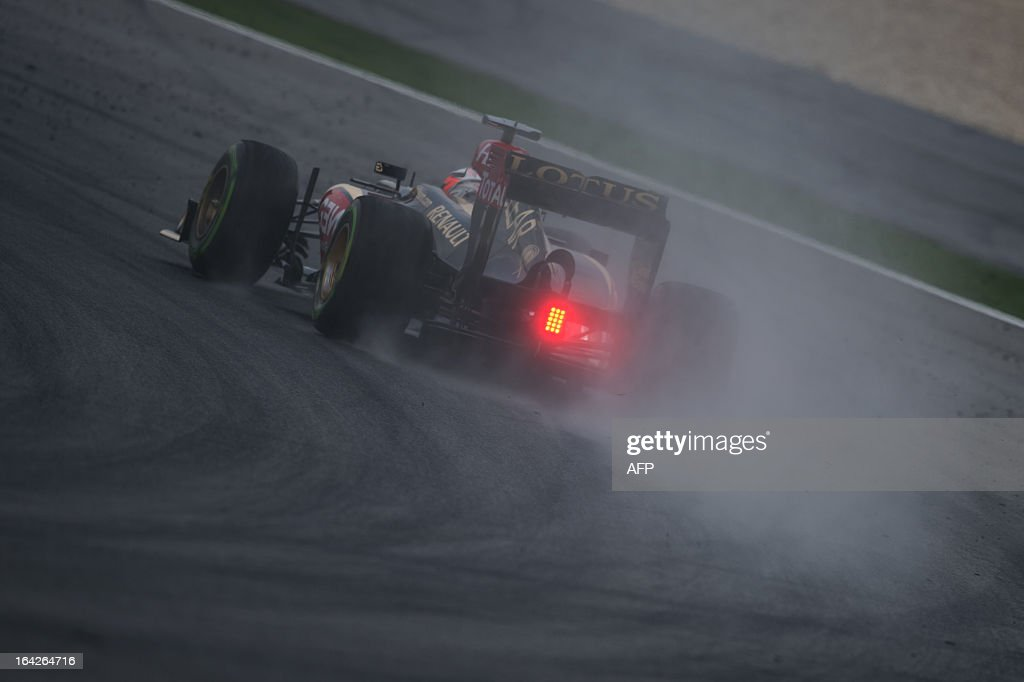 Lotus driver Kimi Raikkonen of Finland takes a corner on the wet track during the second practice session ahead of the Formula One Malaysian Grand Prix at Sepang on March 22, 2013. The Malaysian Grand Prix will take place on March 24.