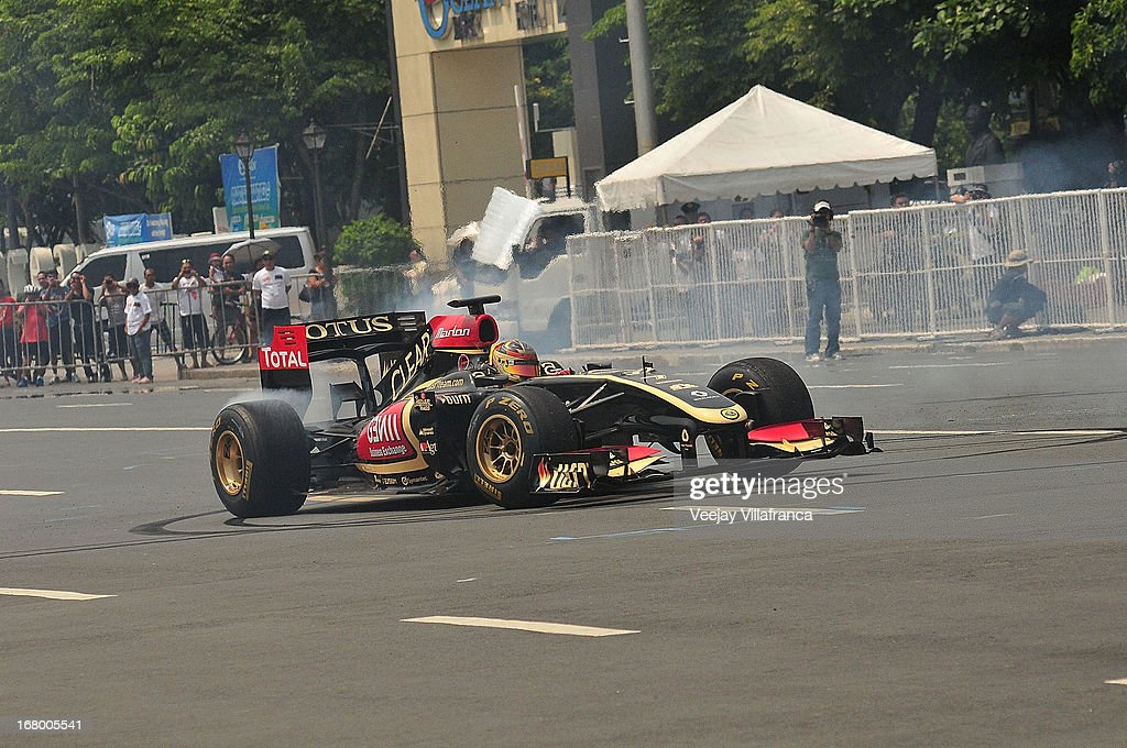 Lotus F1 junior driver Marlon Stockinger executes some exhibition moves during the car demo at the Quirino grandstand on May 4, 2013 in Manila, Philippines. The Formula 1 Lotus team was in the Philippines for a promotional tour and also hoping to gather support for their Filipino-Swiss junior driver and also to drum up interest in the sport.