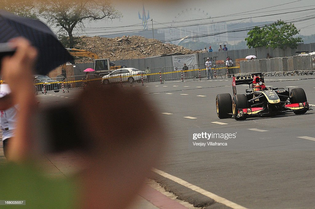 Lotus F1 junior driver Marlon Stockinger exhibits his extraordinary driving skills during the car demo at the Quirino grandstand on May 4, 2013 in Manila, Philippines. The Formula 1 Lotus team was in the Philippines for a promotional tour and also hoping to gather support for their Filipino-Swiss junior driver and also to drum up interest in the sport.