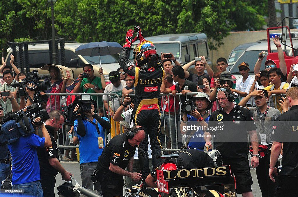 Lotus F1 junior driver Marlon Stockinger waves to the crowd after his exhibition run at the Quirino grandstand on May 4, 2013 in Manila, Philippines. The Formula 1 Lotus team was in the Philippines for a promotional tour and also hoping to gather support for their Filipino-Swiss junior driver and also to drum up interest in the sport.