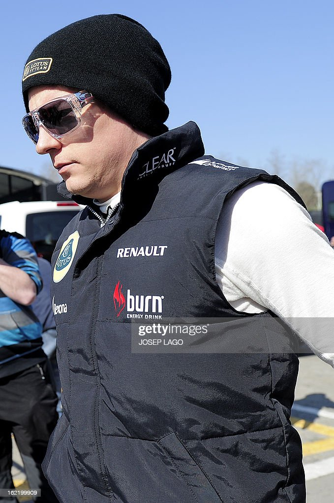 Lotus F1 team Finish driver Kimi Raikkonen walks in the paddock during the second day of Formula One testing at Catalunya's racetrack in Montmelo, near Barcelona, on February 20, 2013.