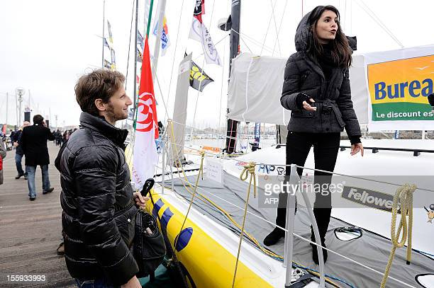 Lotus F1 Team's French driver Romain Grosjean and his girlfriend Marion Jolles are seen on the monohull 'Bureau Vallee' on November 9 2012 in Les...