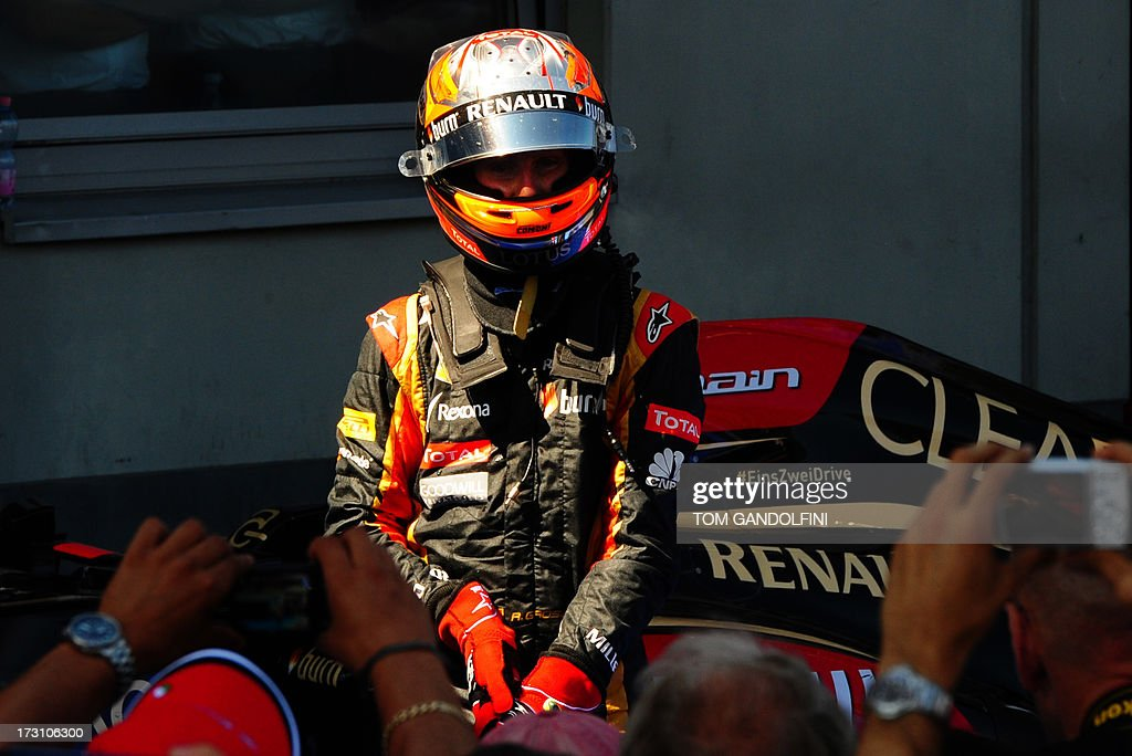 Lotus F1 Team's French driver Romain Grosjean celebrates his third place in the parc ferme at the Nuerburgring circuit on July 7, 2013 in Nuerburg, western Germany, after the German Formula One Grand Prix.