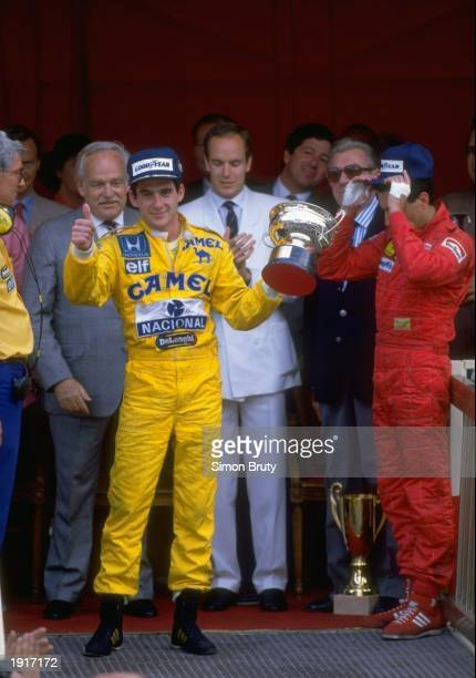 Lotus Honda driver Ayrton Senna of Brazil holds the trophy after his victory in the Monaco Grand Prix at the Monte Carlo circuit in Monaco Mandatory...