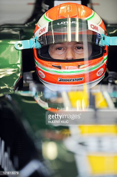Lotus racing's Italian driver Jarno Trulli sits in his car in the pits of the Istanbul Park circuit on May 28 during the second free practice session...