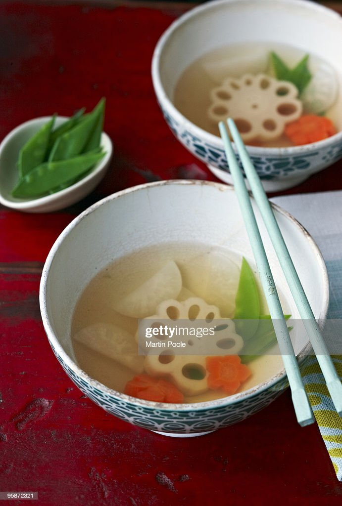 Lotus root soup in bowls on table : Stock Photo