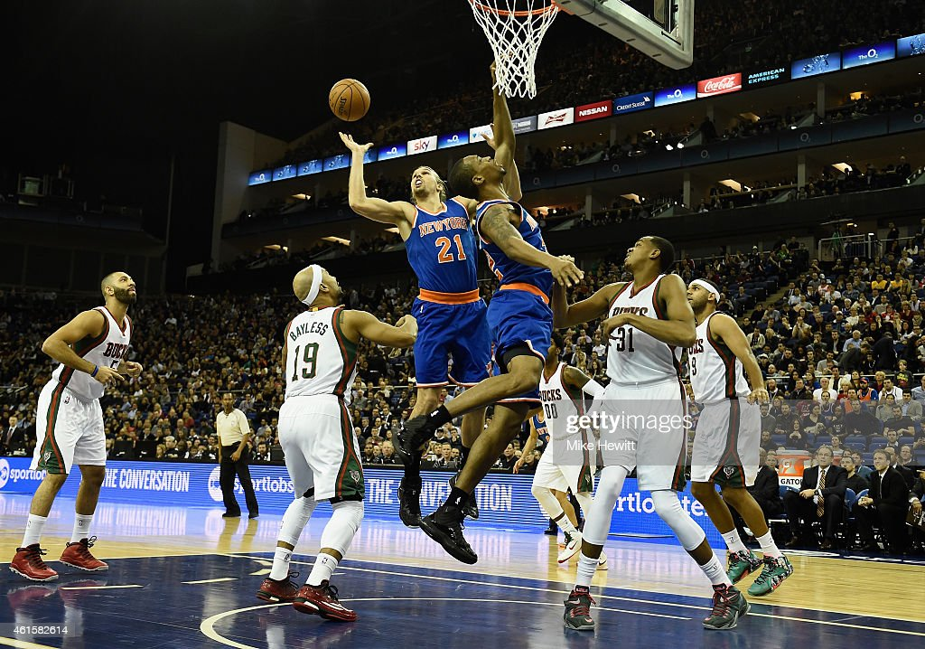 Lou Amundsen and Lance Thomas of New York Knicks struggle to score during the NBA match between New York Knicks and Milwaukee Bucks at O2 Arena on...
