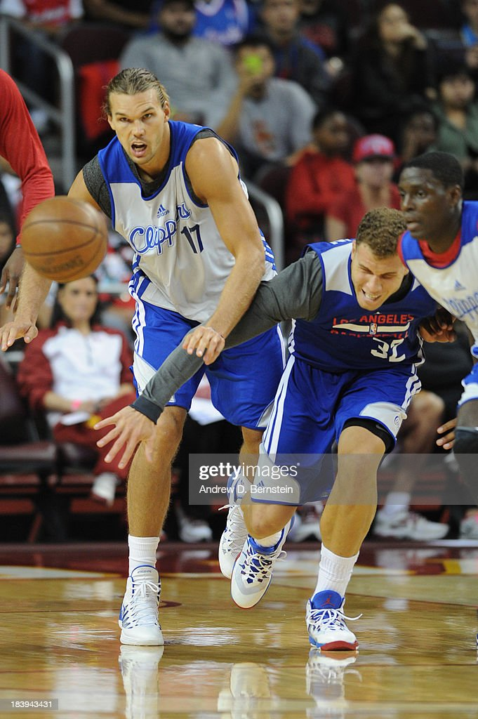 Lou Amundson #17 and Blake Griffin #32 of the Los Angeles Clippers attempt to gain procession of the basketball during an open scrimmage at Galen Center on October 9, 2013 in Los Angeles, California.