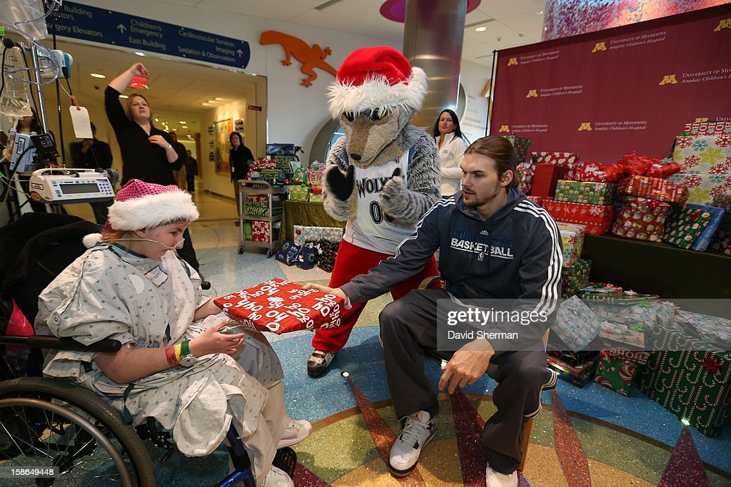 Lou Amundson and Mascot Crunch of the Minnesota Timberwolves distribute holiday gifts collected through the Minnesota Timberwolves Fastbreak Foundation Toy Drive to patients and families on December 21, 2012 at the University of Minnesota Amplatz Children's Hospital in Minneapolis, Minnesota.