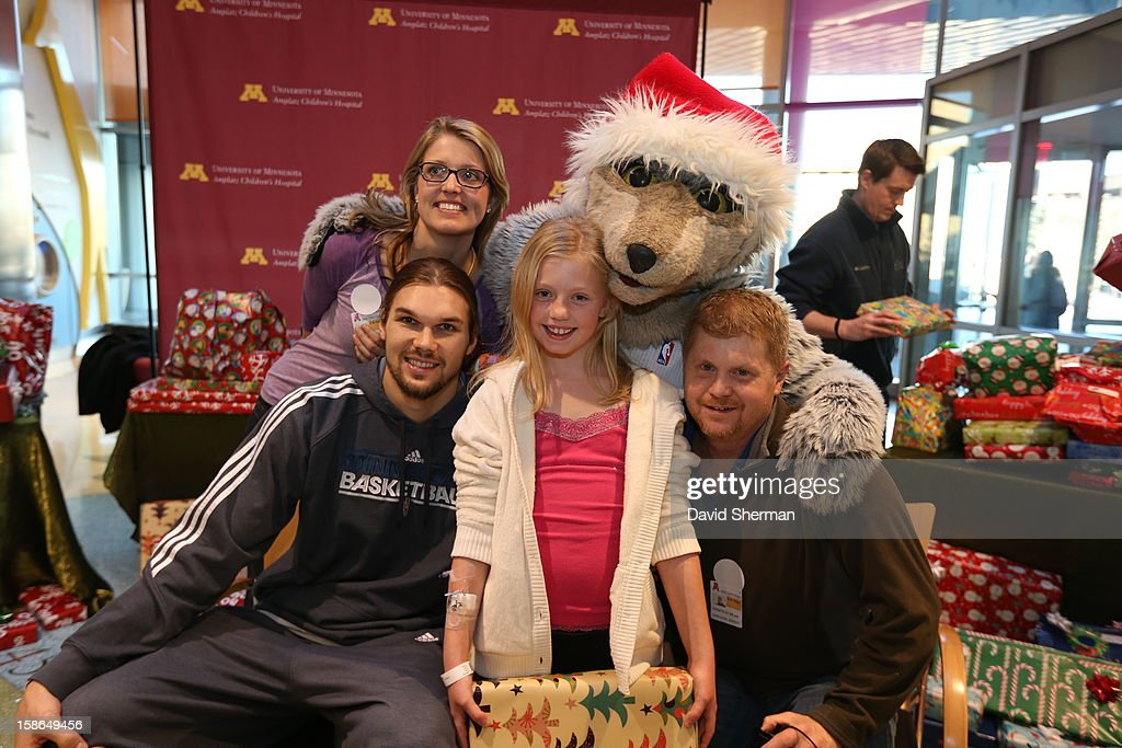 Lou Amundson and mascot Crunch of the Minnesota Timberwolves pause from distributing holiday gifts collected through the Minnesota Timberwolves Fastbreak Foundation Toy Drive to patients and families for a photograph on December 21, 2012 at the University of Minnesota Amplatz Children's Hospital in Minneapolis, Minnesota.