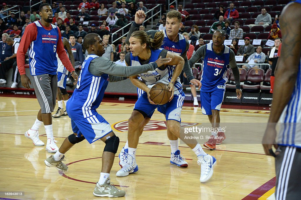 Lou Amundson #17 handles the basketball while being guarded by Chris Paul #3 during an open scrimmage at Galen Center on October 9, 2013 in Los Angeles, California.