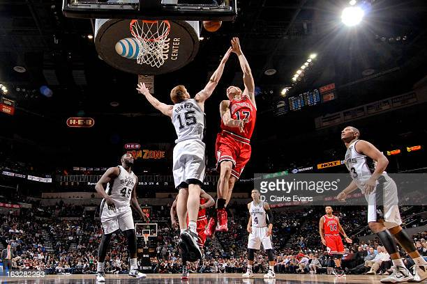 Lou Amundson of the Chicago Bulls shoots in the lane against Matt Bonner of the San Antonio Spurs on March 6 2013 at the ATT Center in San Antonio...