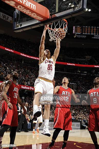 Lou Amundson of the Cleveland Cavaliers dunks against the Atlanta Hawks on November 15 2014 at Quicken Loans Arena in Cleveland Ohio NOTE TO USER...