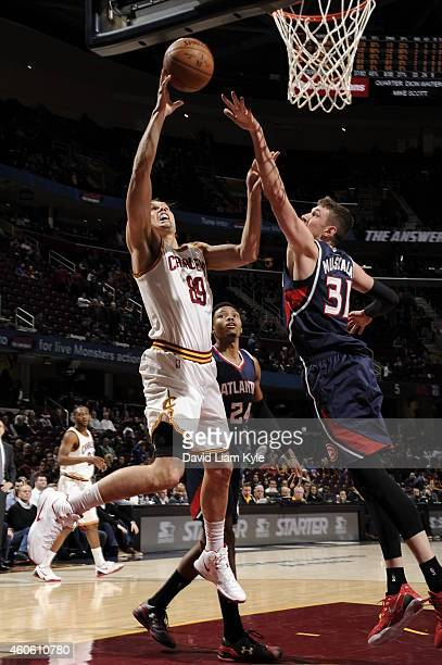 Lou Amundson of the Cleveland Cavaliers goes up for a shot against the Atlanta Hawks on December 17 2014 at Quicken Loans Arena in Cleveland Ohio...