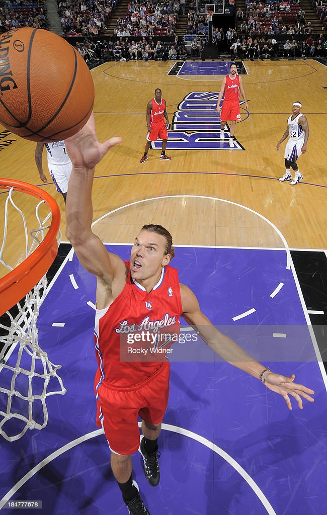 Lou Amundson #17 of the Los Angeles Clippers attempts to tip the ball in against the Sacramento Kings on October 14, 2013 at Sleep Train Arena in Sacramento, California.