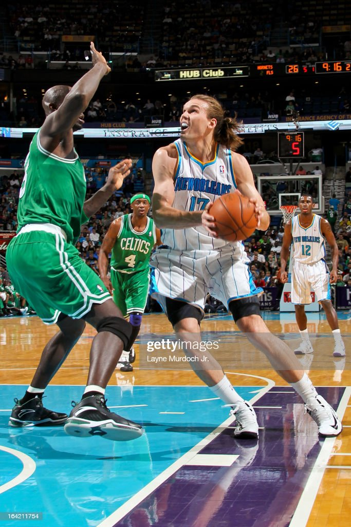 Lou Amundson #17 of the New Orleans Hornet drives to the basket against Kevin Garnett #5 of the Boston Celtics on March 20, 2013 at the New Orleans Arena in New Orleans, Louisiana.