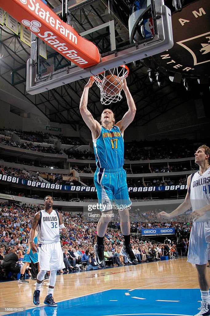 Lou Amundson #17 of the New Orleans Hornets dunks against Dirk Nowitzki #41 of the Dallas Mavericks on April 17, 2013 at the American Airlines Center in Dallas, Texas.
